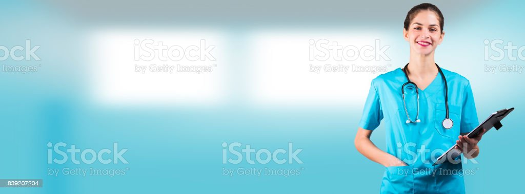 beautiful woman nurse or doctor is holding a notepad board with copy space for an advertising cover picture stock photo