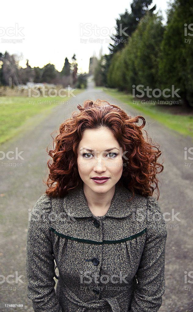 Beautiful Woman on a country road stock photo