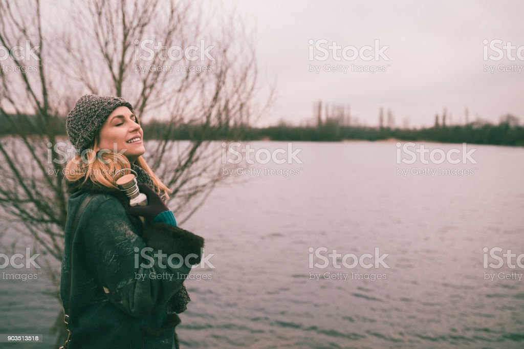 Beautiful woman on a lovely winter day near the lake in Germany stock photo