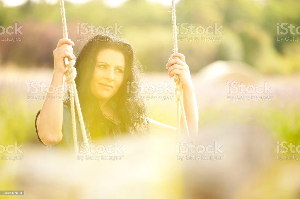 Beautiful Woman on a Swing stock photo