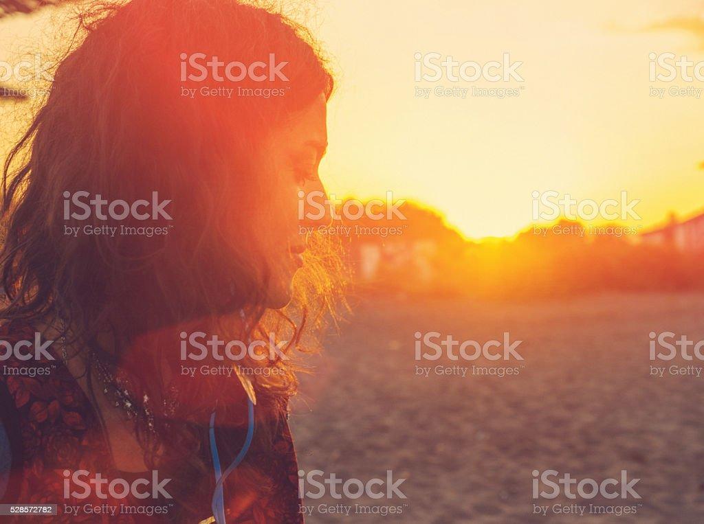 beautiful woman on beach at sunset stock photo