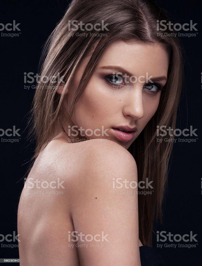 Beautiful woman on black background royaltyfri bildbanksbilder