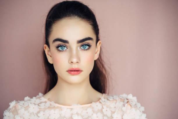 Beautiful woman on dark background stock photo