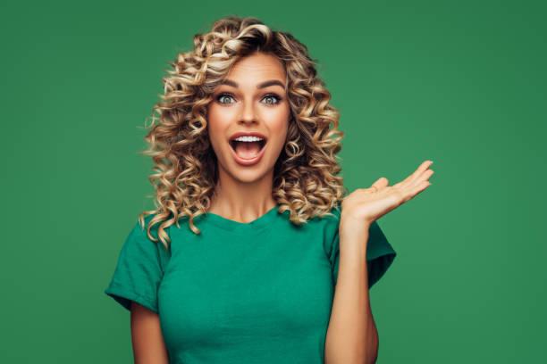 Beautiful woman on green background stock photo
