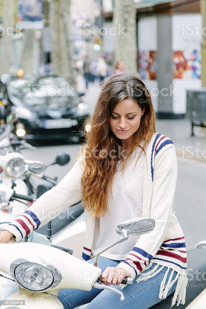 Beautiful woman on moped, Barcelona royalty-free stock photo