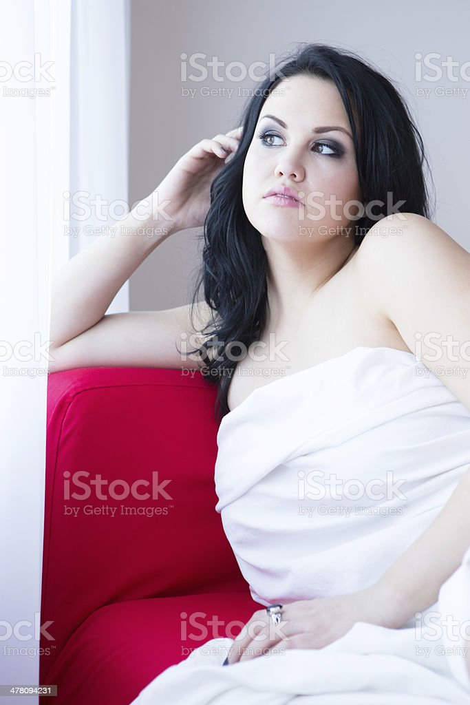 Beautiful woman on red couch portrait royalty-free stock photo