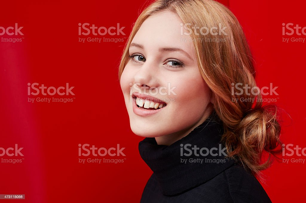 Beautiful woman on red stock photo
