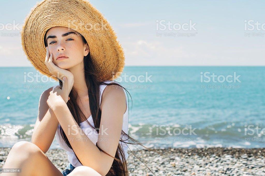 Beautiful woman on sea vacation stock photo