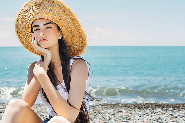 beautiful woman on sea vacation - beach fashion stock photos and pictures