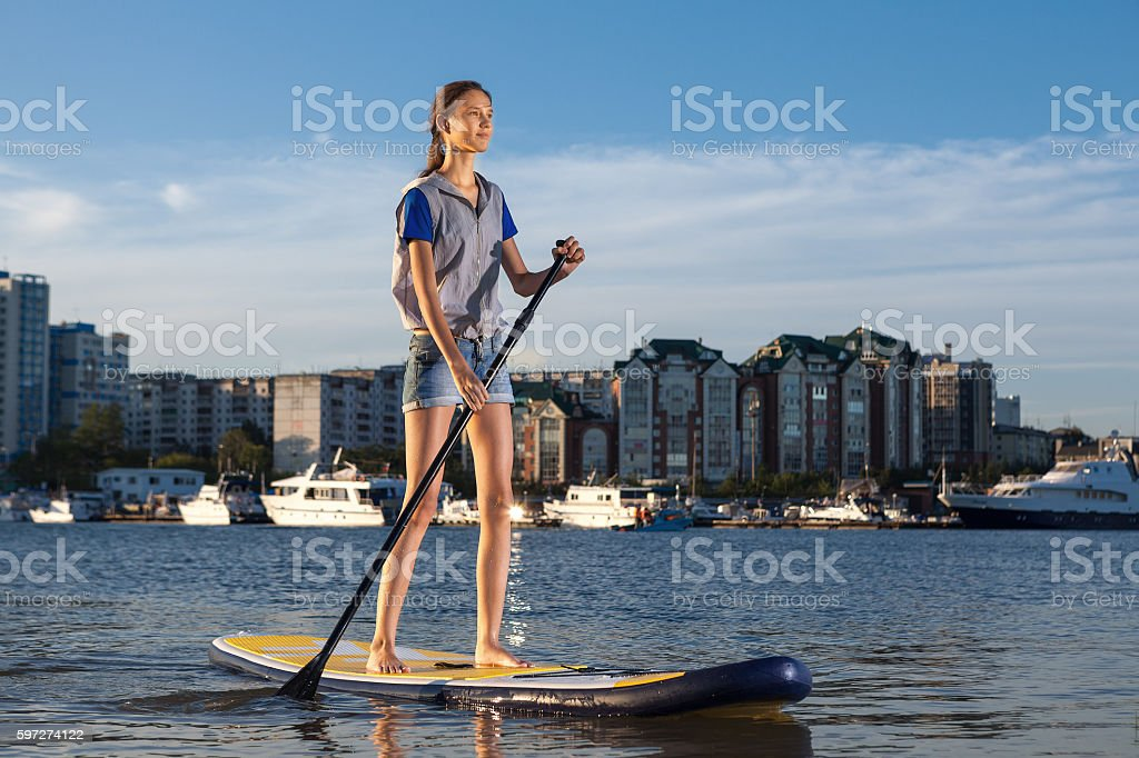 Beautiful woman on Stand Up Paddle Board. SUP. Lizenzfreies stock-foto