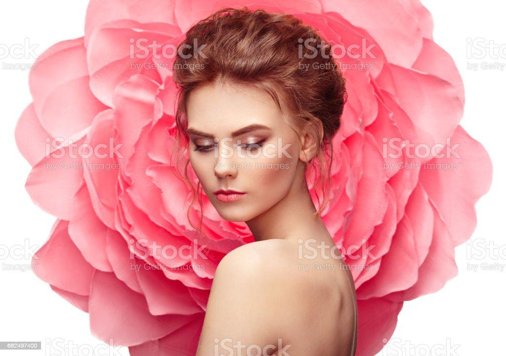 Beautiful woman on the background of a large flower Стоковые фото Стоковая фотография