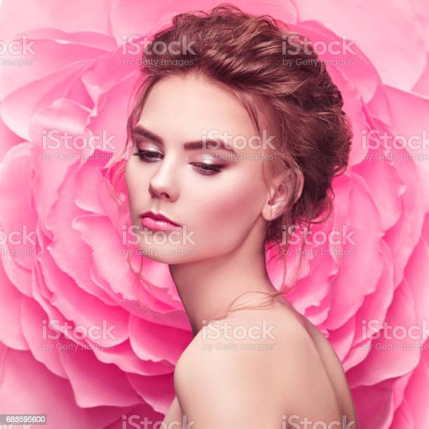 Beautiful woman on the background of a large flower picture id688595600?b=1&k=6&m=688595600&s=612x612&h=jt95r4aor5orrvsvoqdnwvouw2rtmcli dln80svnja=