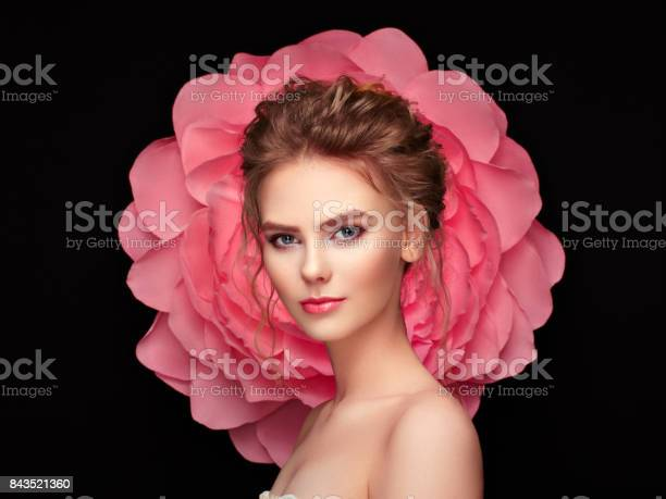 Beautiful woman on the background of a large flower picture id843521360?b=1&k=6&m=843521360&s=612x612&h=6oxk1dlwsqjjhol5ob3eeqk e 1dsciee1cv7p4htzo=