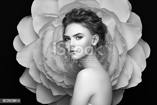 istock Beautiful woman on the background of a large flower 922929814