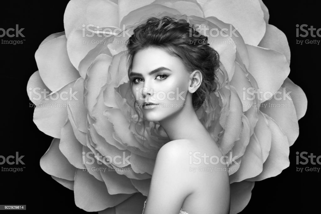 Beautiful woman on the background of a large flower stock photo