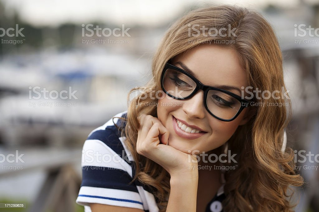 Beautiful woman on the background of bay stock photo