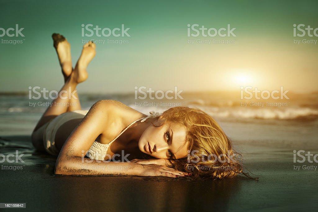 Beautiful woman on the beach royalty-free stock photo