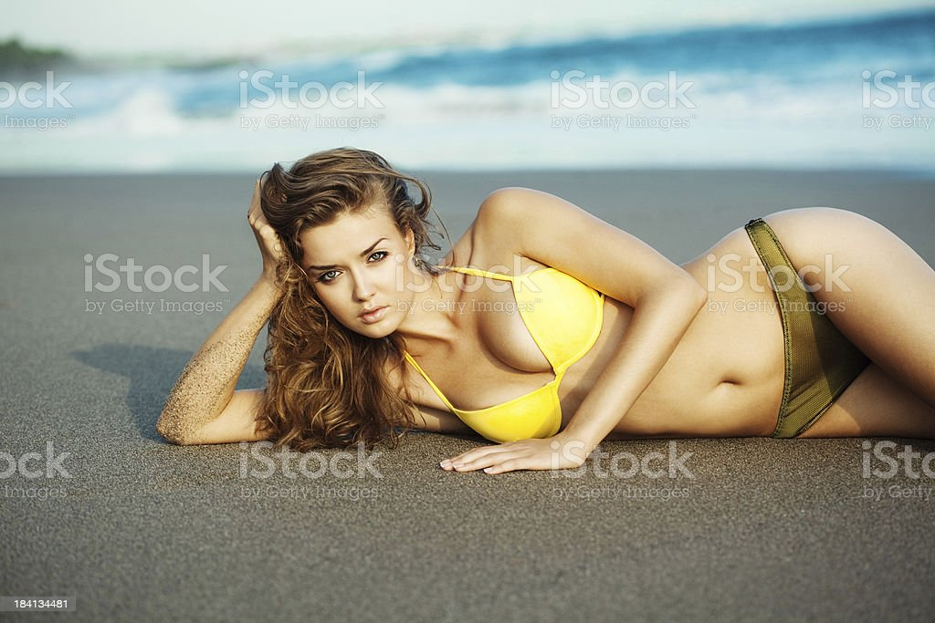 Beautiful woman on the beach royalty-free stock photo