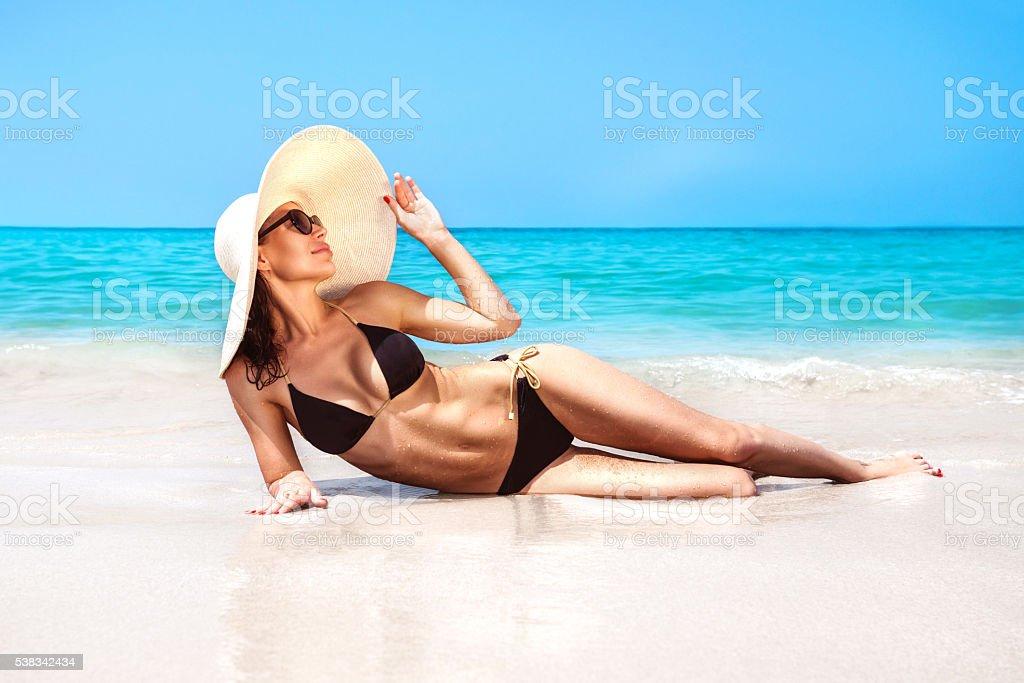 Beautiful woman on the beach stock photo