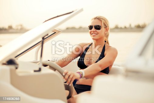 Beautiful woman steering the boat.