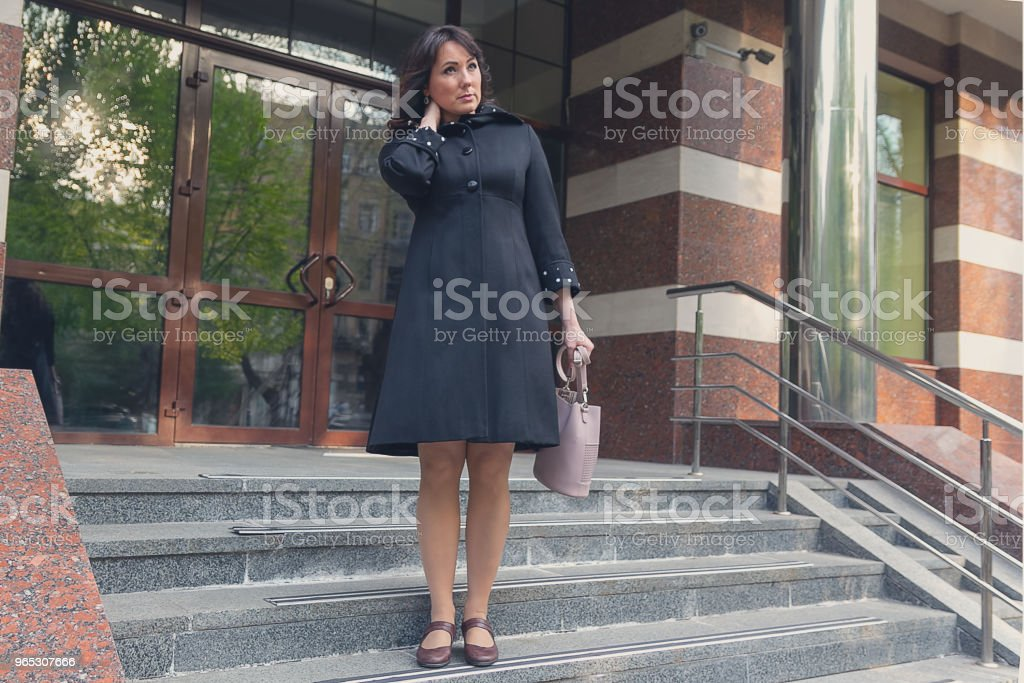 Beautiful woman on the steps of office. Business zbiór zdjęć royalty-free