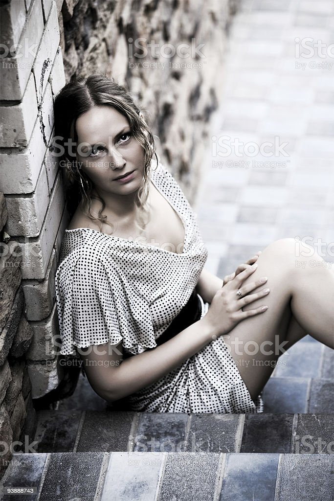 Beautiful woman on the steps royalty-free stock photo