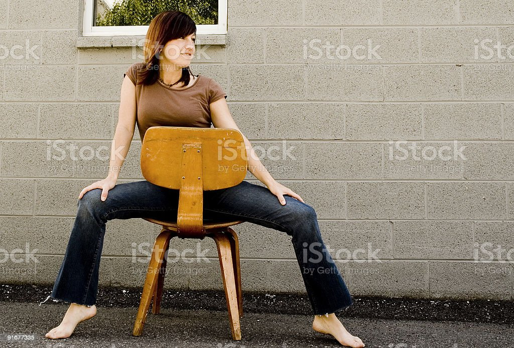 beautiful woman on vintage chair royalty-free stock photo