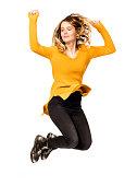 istock beautiful woman on white background jumping happiness 628946556