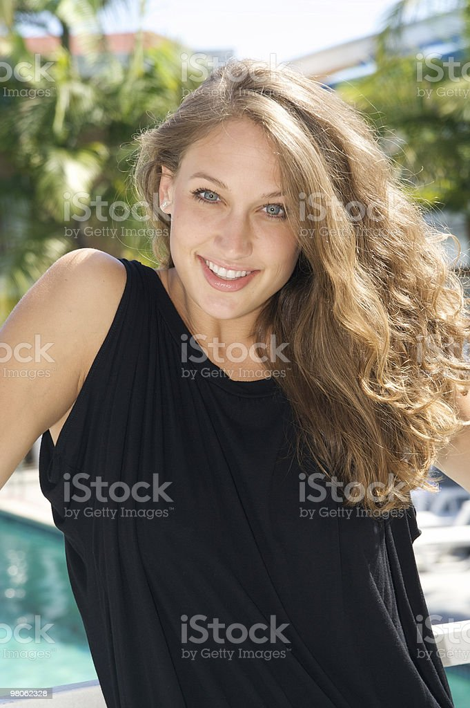 Beautiful Woman Outdoors at a Resort royalty-free stock photo