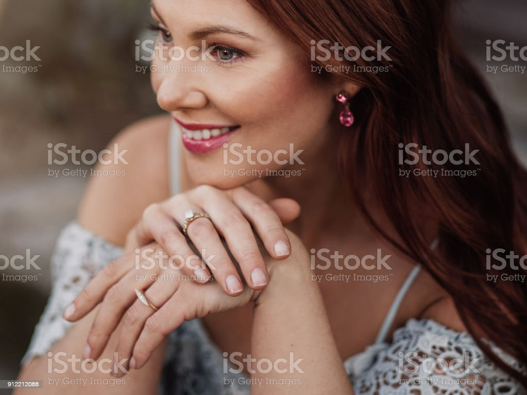Beautiful woman outdoors during day in early spring stock photo