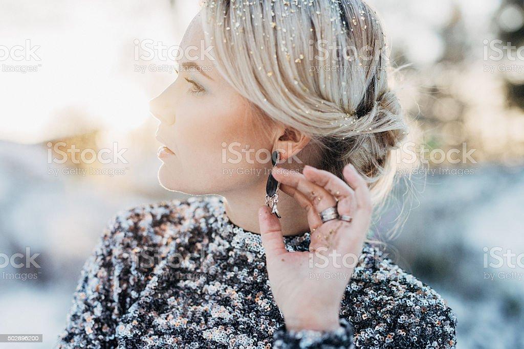 Beautiful woman outdoors in winter stock photo