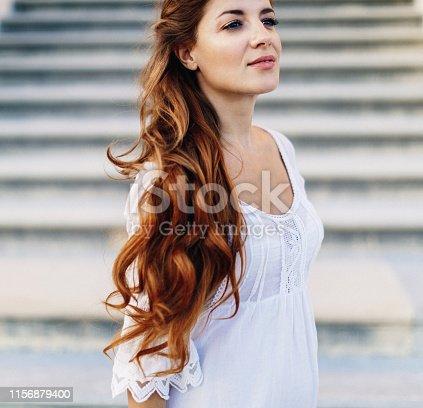 istock Beautiful woman outdoors 1156879400