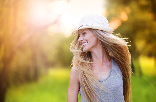 istock Beautiful woman outside in a park. 535200347