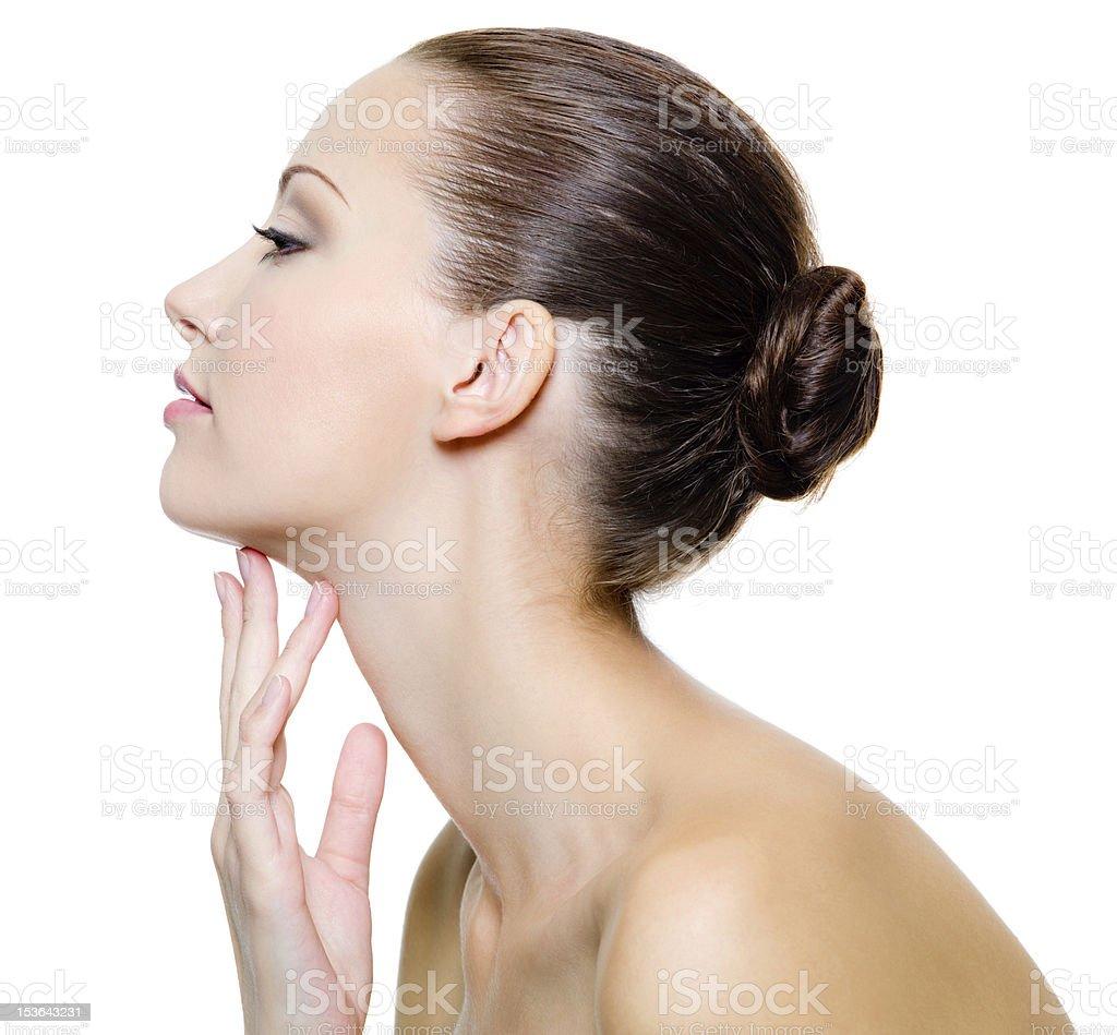Beautiful woman pampering the neck stock photo