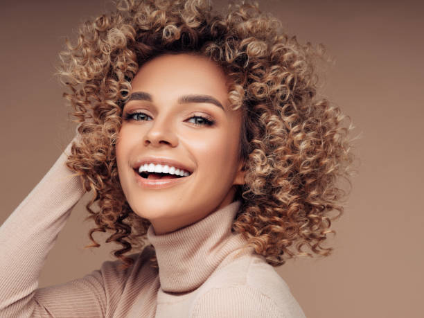 Beautiful woman Beautiful woman curly hair stock pictures, royalty-free photos & images