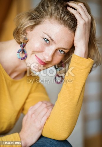 Close-up portrait of a beautiful woman looking at camera