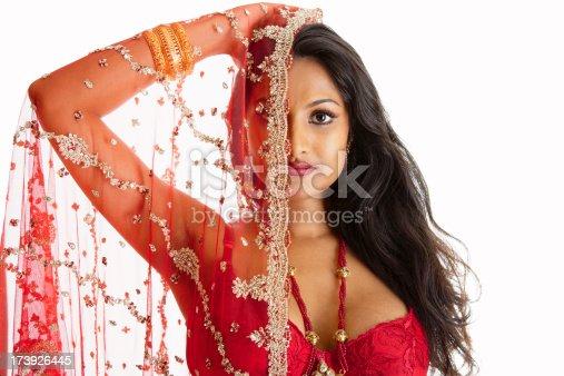 Beautiful Asian woman holding up a wedding veil.