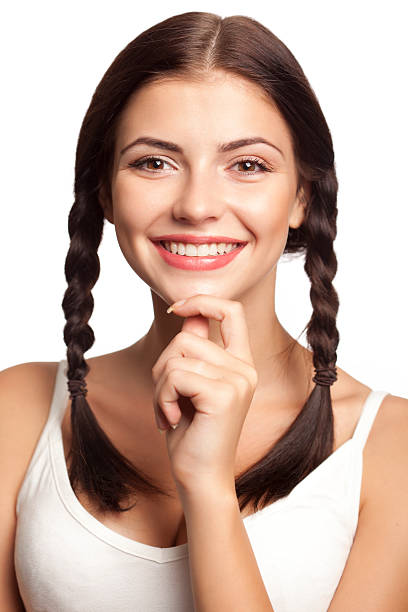 beautiful woman - pigtails stock photos and pictures