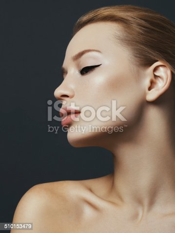 Portrait of beautiful blonde woman with cat-eye make up. High-end retouch.