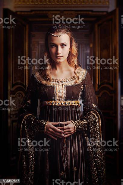 Portrait of a beautiful woman. Medieval style.