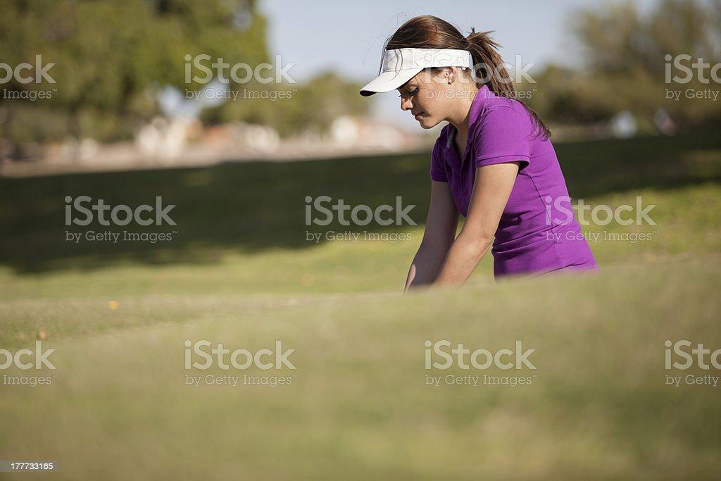 Beautiful woman playing golf stock photo