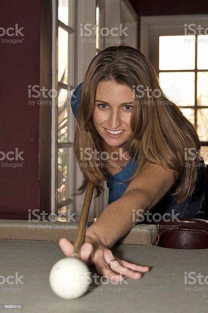 Beautiful Woman Playing Pool royalty-free stock photo
