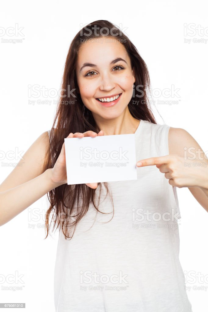 Beautiful woman pointing at a blank business card royalty-free stock photo