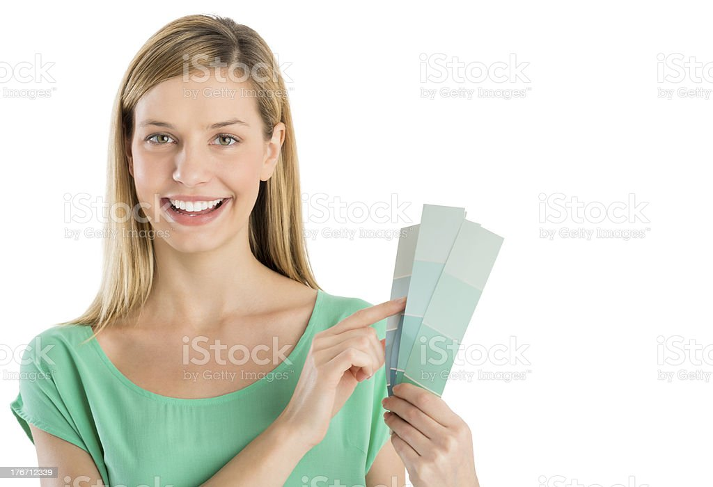 Beautiful Woman Pointing At Color Swatches royalty-free stock photo