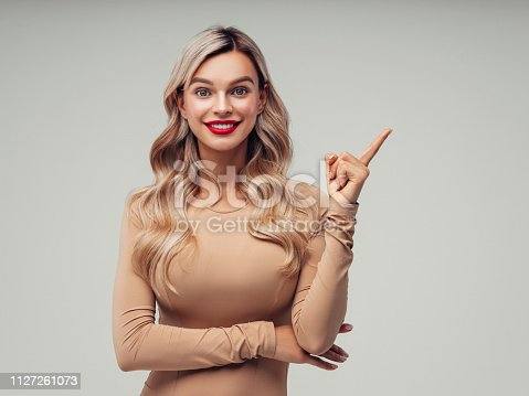 Beautiful woman pointing at side