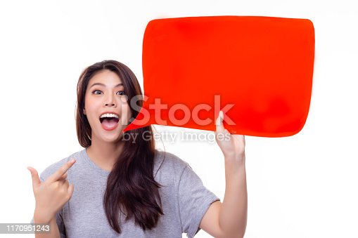Beautiful woman pointing finger to announcement or balloon paper. Pretty girl telling someone, it has interesting things or advertising some product, brand, goods. isolated on white background