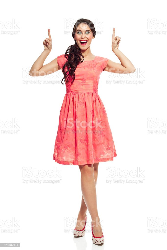 Beautiful woman pointing Full lenght portrait of beautiful young woman pointing with index fingers and laughing at the camera. Studio shot, isolated on white. 20-24 Years Stock Photo