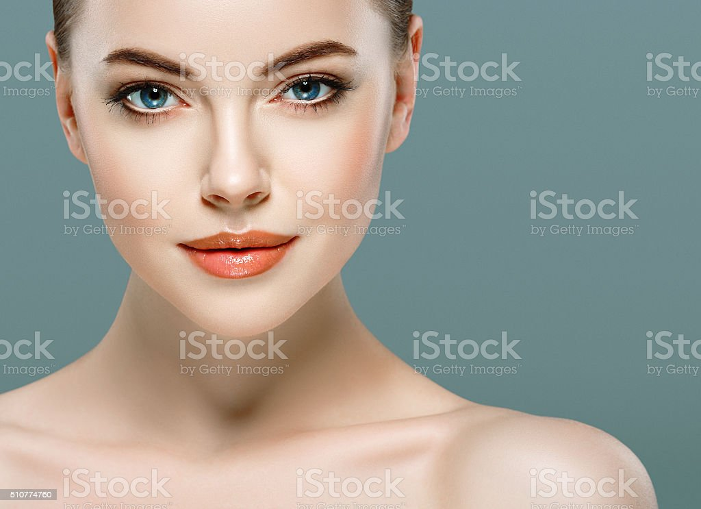 Beautiful woman portrait face close up studio gray background stock photo