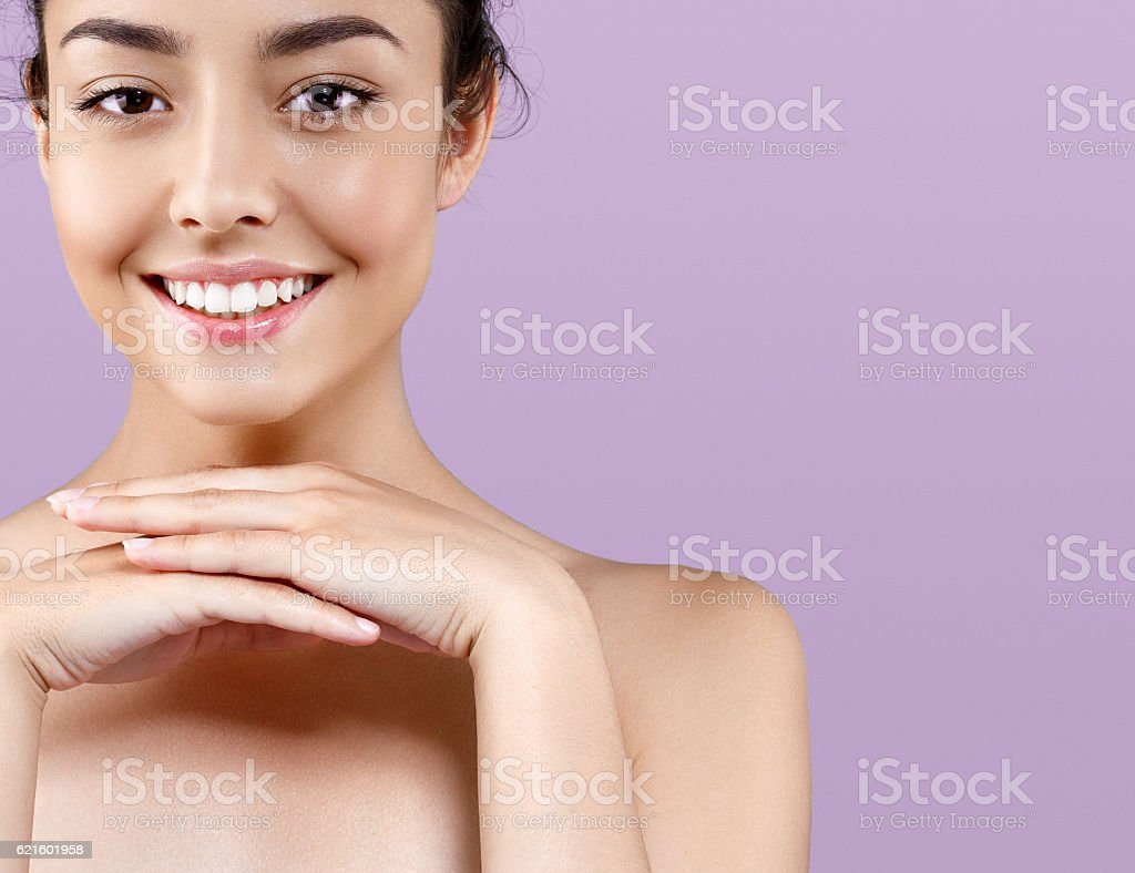 Beautiful woman portrait healthy skin perfect makeup. Pink background. – zdjęcie
