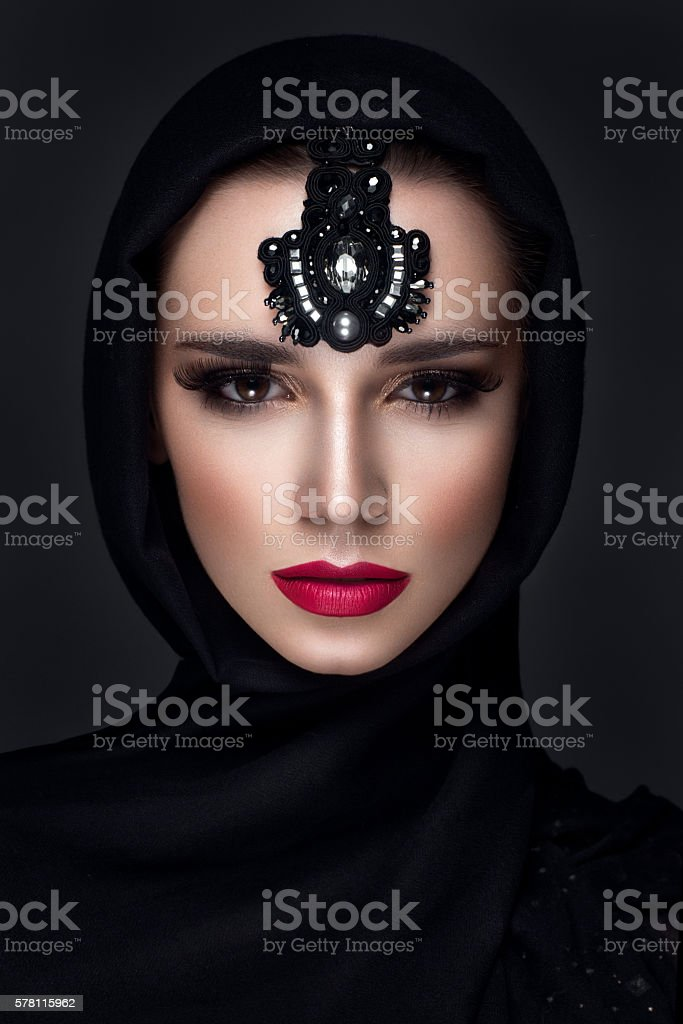 Beautiful woman portrait in east style with headscarf stock photo